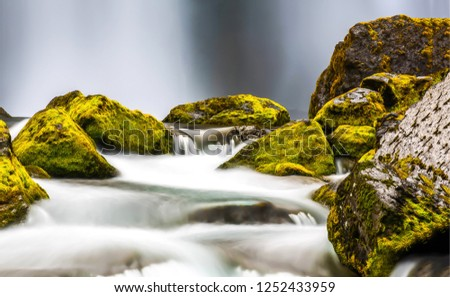 Waterfall mossy rocks view. Mossy rocks waterfall stream. Waterfall rocks stream Waterfall close up view