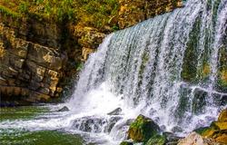 Waterfall mountain river water view. Waterfall mountain rock. Waterfall view