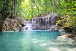 Waterfall named Erawan at 5th level. That famous attraction of Kanjanaburi province of Thailand. It represents landscape, scenic, cascade, nature and forest for travel background.