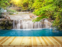 Waterfall named Erawan. That famous attraction of Kanchanaburi province of Thailand. Montage with tile floor. It represents landscape, scenic, cascade, nature and forest for travel background.