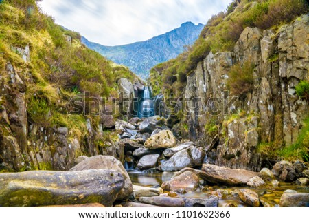 Waterfall near Llyn Idwal a small lake that lies within Cwm Idwal in the Glyderau mountains of Snowdonia. #1101632366