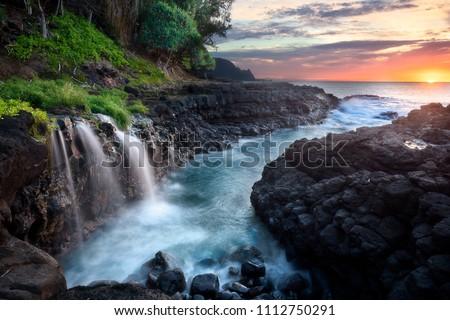 Waterfall near Queen's Bath at sunset, Kauai, Hawaii Stock photo ©