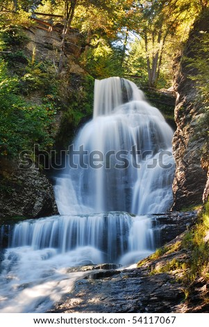 Waterfall of Digman Falls with rock and woods in Autumn. - stock photo
