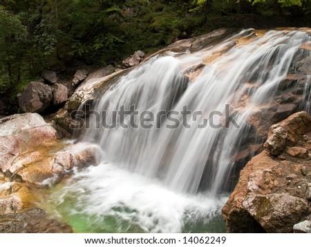 Waterfall on fast mountain river horizontal shot