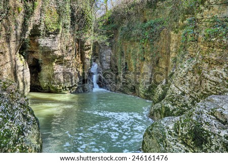 Waterfall on the river Agura in Agursky gorge on the territory of the Khosta district of Sochi in Krasnodar Krai of Russia