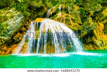 Waterfall pool in tropical forest. Mountain waterfall pool