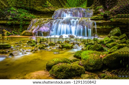 Waterfall river mossy rocks view. Mossy waterfall river rocks. River waterfall stream scene