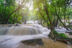 Waterfall scene at Pha Tad Waterfalls in rainforest  at the Khuean Srinagarindra National Park Kanchanaburi Thailand.