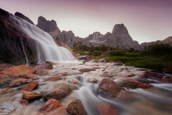 Waterfall sunset in the Wind River Mountains, Wyoming, USA.