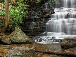 Waterfall with mountain laurel and boulders.  Benton Falls