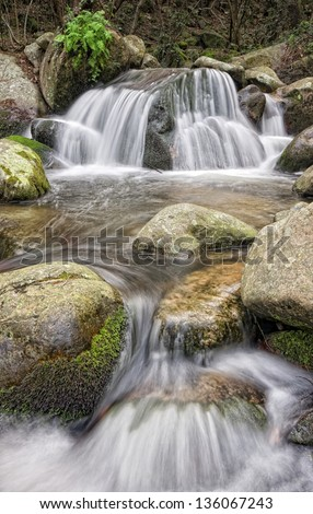 Waterfall with round stones