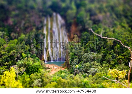 waterfall with tilt-shift effect looking like a miniature - stock photo