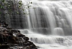 Waterfall with tree and rock bank.  Benton Falls