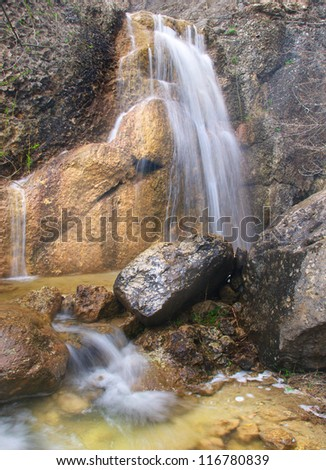 Waterfalls and large stones. Natural composition