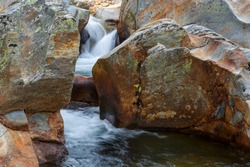 Waterfalls and rocks eroded by the passage of water in the Truchillas River. Pozas de Remolín, Sierra de la Cabrera, León, Spain.