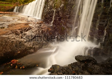 Waterfalls at a dam - stock photo