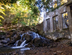 Waterfalls at the ruins of the Carbide-Wilson Mill in Gatineau Park in autumn, Quebec, Canada
