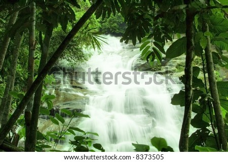 waterfalls in green forest - stock photo