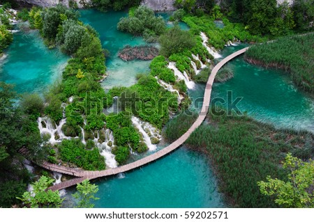 Waterfalls in Plitvice National Park. Aerial view. One vivid turquoise lake flows into another.