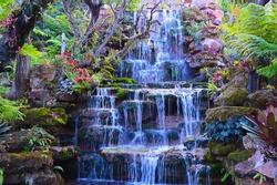 Waterfalls in Thailand. Pictures of waterfalls in a beautiful garden at Wat Pha Phaen. Sakon Nakhon Province, Thailand