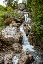 Waterfalls of fresh and pure water along the hiking trails on the Alpe di Siusi in the South Tyrolean dolomites.
