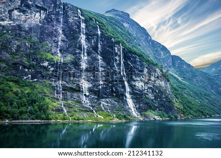 waterfalls Seven Sisters, Geiranger fjord, Norway landscape with mountains.