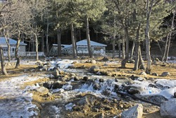 Waterflow in the woods,rocks and leaf fall during snow fall in naran valley, kpk Pakistan