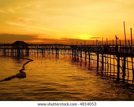 Waterfront Fishing Village Sunset - stock photo