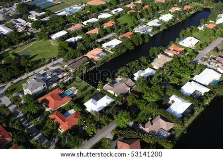 Waterfront houses in a suburban Miami neighborhood.