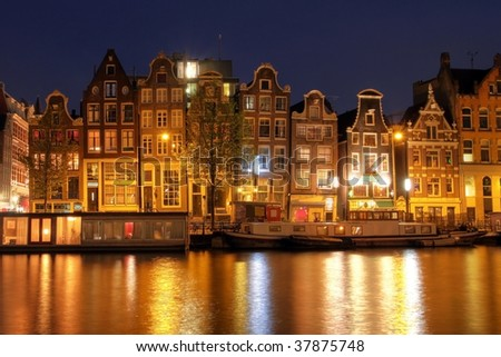 Waterfront houses in Amsterdam at night, The Netherlands (HDR image)