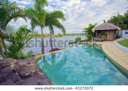 Waterfront Mansion with Pool and Bali hut overlooking the canal