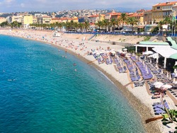 waterfront of Nice with beach and sea, cote dAzur at summer, France,