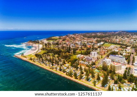 Waterfront of Port Macquarie town on Australian Middle north coast of Pacific ocean along Hastings river on a sunny summer day in aerial view.
