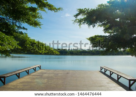 Waterfront pavilion, Waterfront pavilion and blue sky,Waterfront pavilion and Terminalia ivorensis Chev. #1464476444