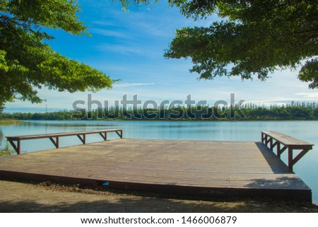 Waterfront pavilion, Waterfront pavilion and blue sky,Waterfront pavilion and Terminalia ivorensis Chev. #1466006879