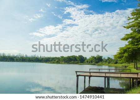Waterfront pavilion, Waterfront pavilion and blue sky,Waterfront pavilion and Terminalia ivorensis Chev. #1474910441
