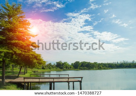 Waterfront pavilion, Waterfront pavilion and sunset,Waterfront pavilion and Terminalia ivorensis Chev. #1470388727
