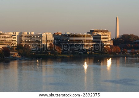 Watergate Complex and Washington Monument in DC at sunset