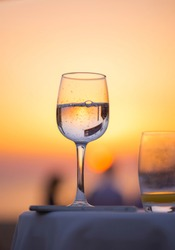 waterglass with beautiful sunset, relaxing at beach