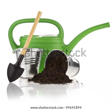 Watering can, bucket, spade, soil on white background