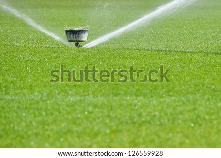 Watering the football field