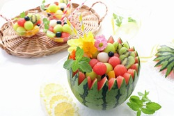 Watermelon balles fruits punch with sparkling water or soda. Summer party idea.