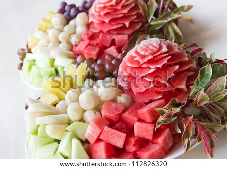 Watermelon carvings on a plate and famous tropical fruits cut professionally