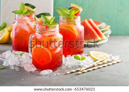 Watermelon lemonade in mason jars with lemon