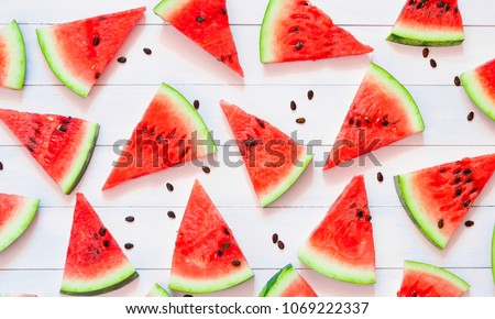 Watermelon pattern. Sliced watermelon on  pink background. Flat lay, top view.