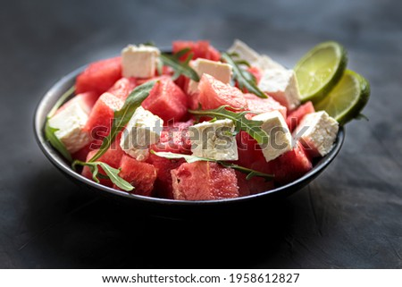Watermelon salad with feta cheese, arugula, lime in bowl. natural helthy cuisine, fresh and tasty vegetable lunch. Mediterranian eating, cool dinner in plate without meat ストックフォト ©