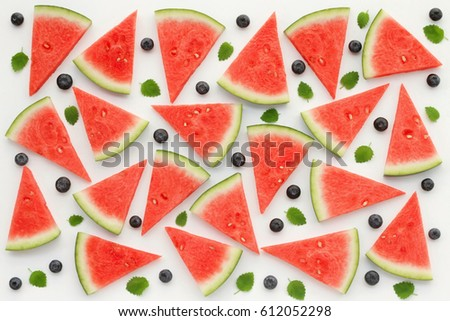 Watermelon slices, blueberries and green mint leaves on white background. Top view, flat lay.