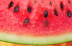 Watermelon with Huge magnified macro shot and close up shot on wood table