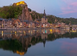 Waterreflection of the old town of Dinant, Belgium