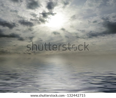 Waterscape with sun behind cloudy sky